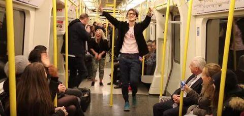 Man dancing on tube