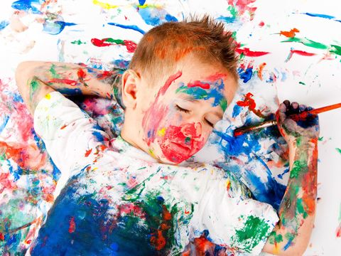 Child sleeping with paint on his face