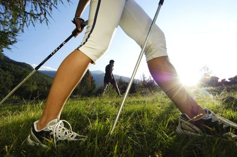 Footwear, Leg, Grass, Human leg, Shoe, People in nature, Summer, Sunlight, Elbow, Knee,