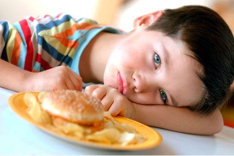 Grumpy child at restaurant