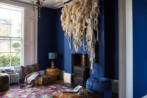 Blue, Room, Interior design, Wood, Home, Wall, Living room, Light fixture, Floor, Interior design,