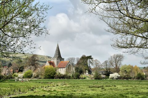 Tree, Land lot, Woody plant, Spire, House, Rural area, Grassland, Medieval architecture, Steeple, Cumulus,