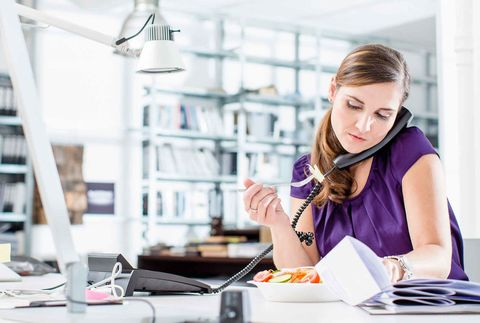Woman eating at her desk