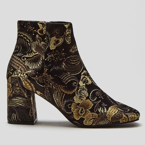 Boot, Pattern, Design, Fashion design, Natural material, Silver, Synthetic rubber, Buckle, Pattern,
