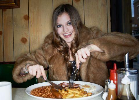 Woman eating junk