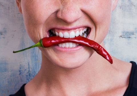 Woman eating chillies