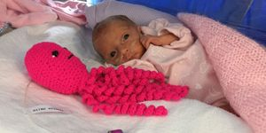 Baby with crocheted octopus