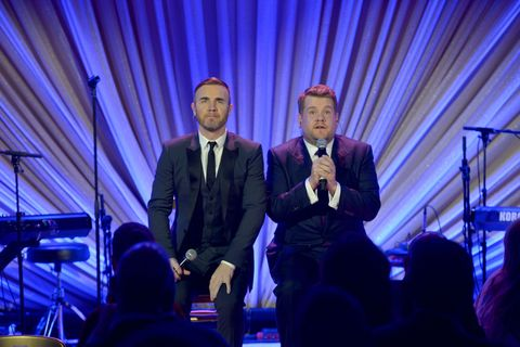 LOS ANGELES, CA - FEBRUARY 21: Singer Gary Barlow (L) and actor/comedian James Corden speak onstage during The Weinstein Company's Academy Awards Nominees Dinner in partnership with Chopard, DeLeon Tequila, FIJI Water and MAC Cosmetics on February 21, 2015 in Los Angeles, California. (Photo by Charley Gallay/Getty Images for TWC)