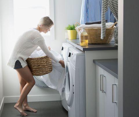 Woman using dryer