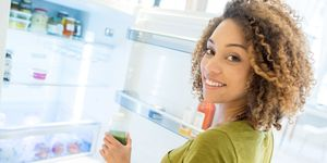 Women looking in fridge