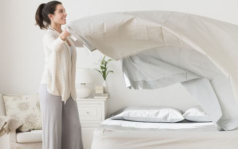woman changing bed