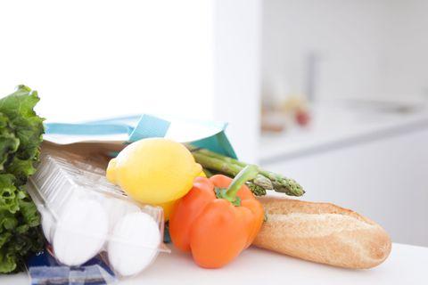 Food -eggs, bread, lemon, pepper - on kitchen counter