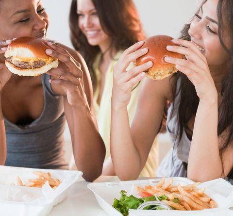 Women eating burgers