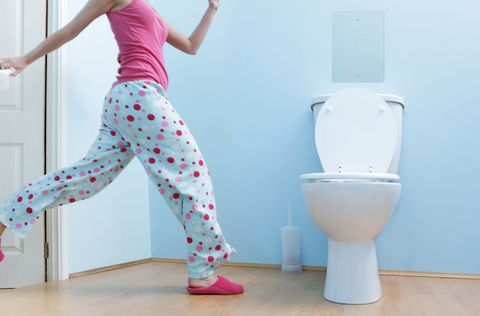 Woman running to the loo