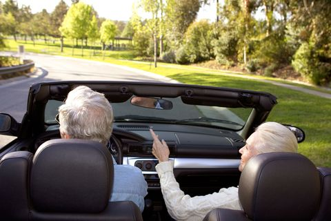 Senior couple driving