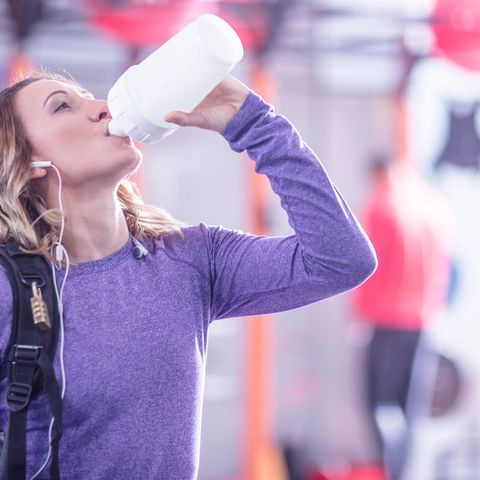 Woman drinking from gym bottle