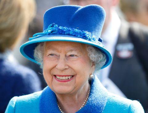 Blue, Hat, Fashion accessory, Cobalt blue, Smile, Electric blue, Headgear, Costume hat, Fedora,