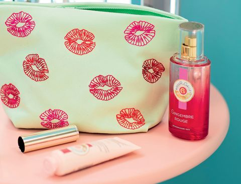 Embroidered make-up bag surrounded by beauty products
