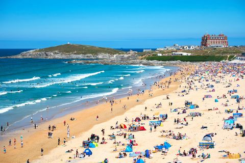 Watergate Bay beach in Cornwall on hot summer's day