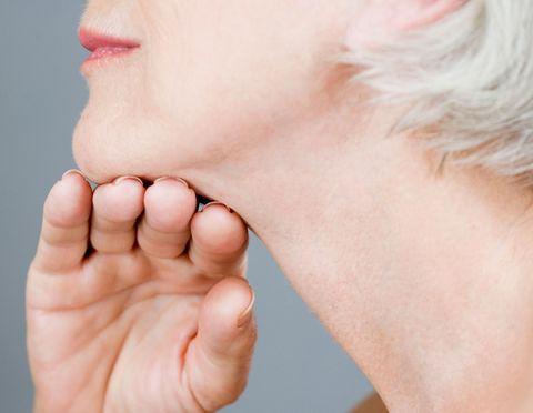 Woman touching chin