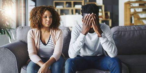 Shot of a young couple having relationship problems at home