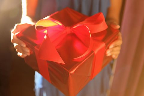 Gift wrapped with gold paper and red ribbon
