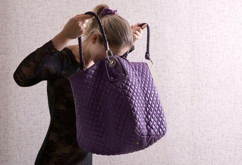 Woman Looks Into Handbag