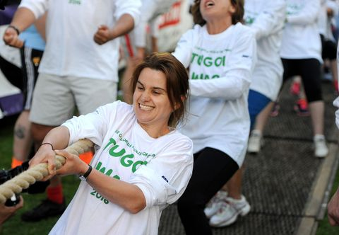 Jo Cox engaged in a tug of war at a charity fundraiser