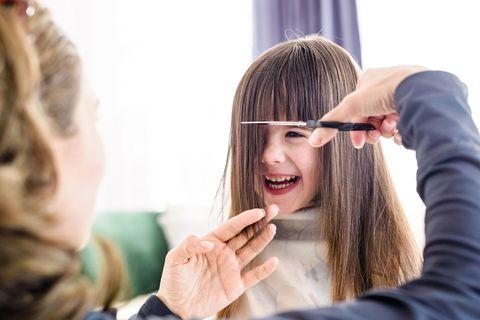 Little girl having haircut