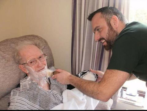 Lenny the dementia friendly barber with a client in a care home