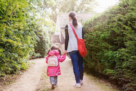 Mum walking daughter to school