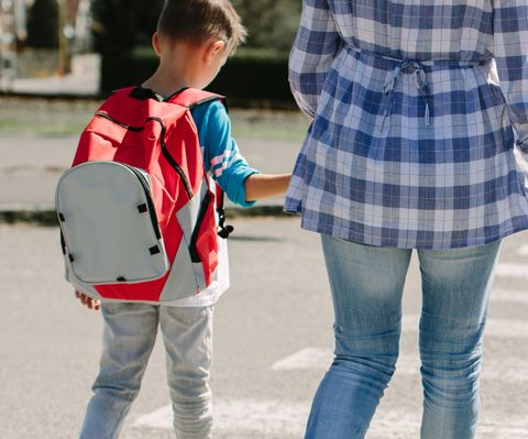Mum and son walking to school