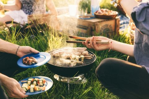 BBQ with tongs in garden