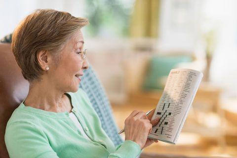 Older woman doing a crossword