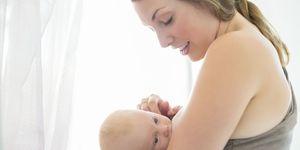 A mother breastfeeding her newborn baby
