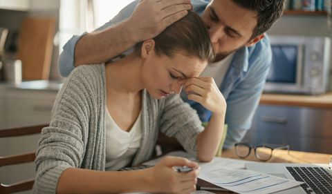 Couple stressed paperwork