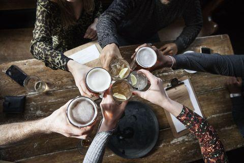 Friends cheers at a pub