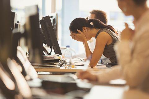 Woman under pressure at her desk