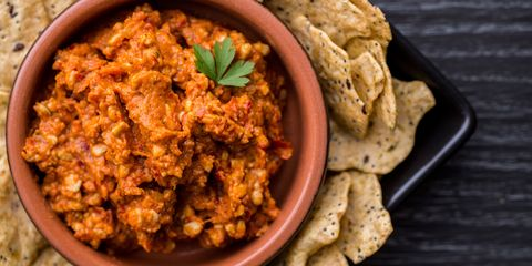 A delicious red pepper and cashew dip with multigrain crackers.