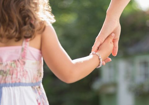 Mum holding hand with daughter