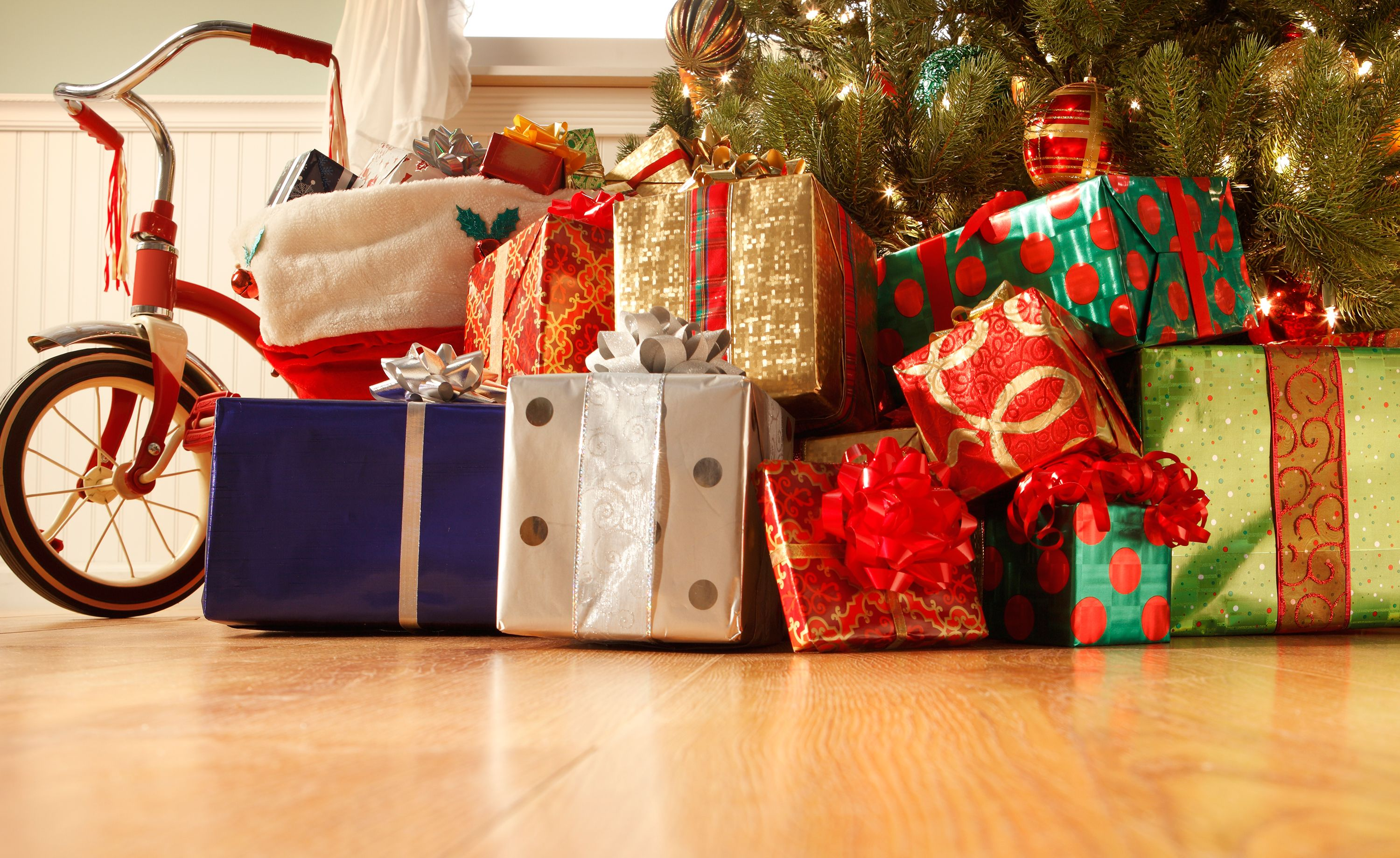Christmas Presents Under Tree.Mumsnet User Sparks Debate About How Many Christmas Presents