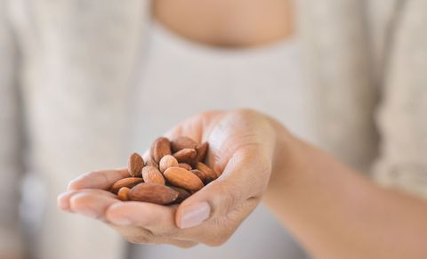 Woman eating nuts
