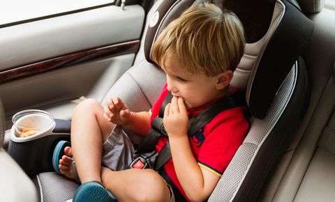 Child eating in car