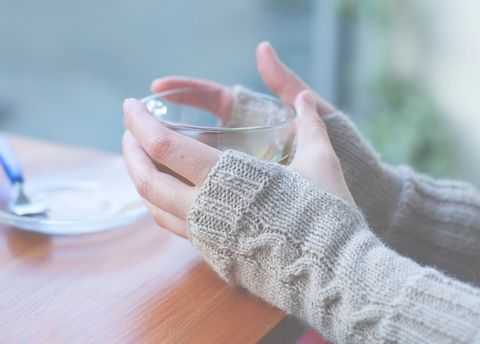 Woman with cold hands