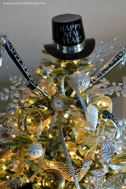 """<p>Tiny timepieces, a party hat tree topper, and shimmering gold and silver ribbon will let your guests know where the party's at.</p><p><em data-redactor-tag=""""em""""><a href=""""https://homeiswheretheboatis.net/2015/12/30/new-years-celebration-with-a-countdown-table-and-tree/"""" target=""""_blank"""" data-tracking-id=""""recirc-text-link"""" data-href=""""https://homeiswheretheboatis.net/2015/12/30/new-years-celebration-with-a-countdown-table-and-tree/"""">Get the tutorial from Home Is Where the Boat Is »</a></em></p>"""