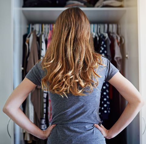 Woman standing in front of wardrobe