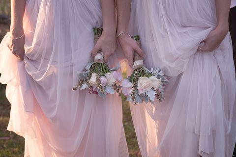 Clothing, Finger, Petal, Bridal clothing, Dress, Bridal accessory, Bouquet, Photograph, Pink, Wedding dress,