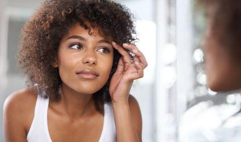 Woman checking eyebrows