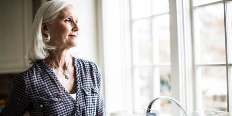 Older woman looking out of window