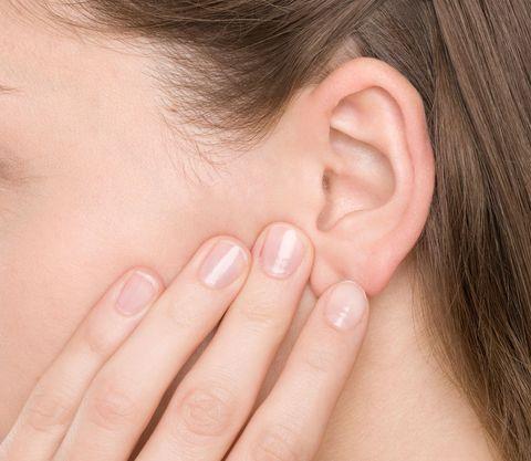 Woman touching ear